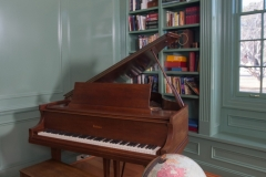 Traditional Colonial Piano That Ties This American Colonial Home's Study