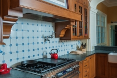 American Colonial Style Tile Backsplash With Traditional Style Cabinets & Stove Top - Colorado Springs Renovation