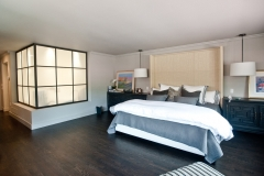 Modern Bedroom with Glass Wall to Bathroom Created By Residential General Contractors Near Me