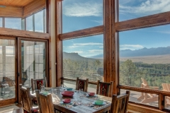 Open Mountain Home Dining Room With Windows For Walls & Breathtaking Views