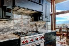 Mountain Home Kitchen Design - Black Kitchen Cabinets With Granite Backsplash