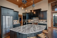 Open Kitchen Design with Large Granite Island in Mountain Home Renovation