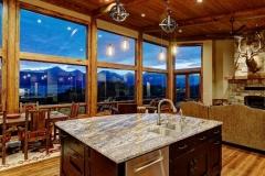 Mountain Home Kitchen Design - Oversized Windows & Large Island