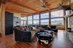 Mountain Inspired Mountain Home Living Room - Oversized Windows & Hardwood Floors